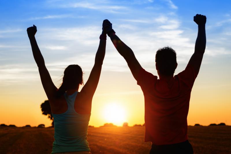 stock image-couple-armsup
